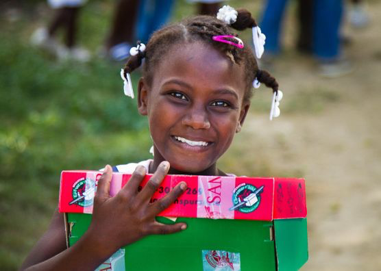Operation Christmas Child girl with present